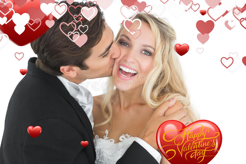 Composite image of handsome bridegroom kissing his wife on her cheek. Handsome bridegroom kissing his wife on her cheek against happy valentines day stock illustration