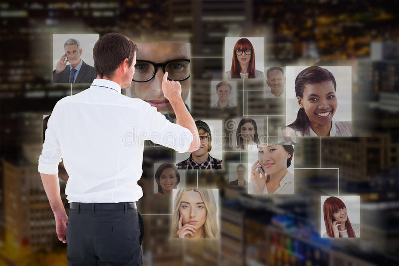 Composite image of handsome businessman pointing at a copy space stock images