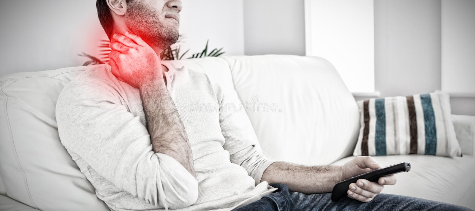 Composite image of handsome man suffering from painful neck. Handsome man suffering from painful neck against highlighted pain stock photography