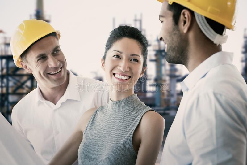 Composite image of happy architect discussing over blueprint stock photos