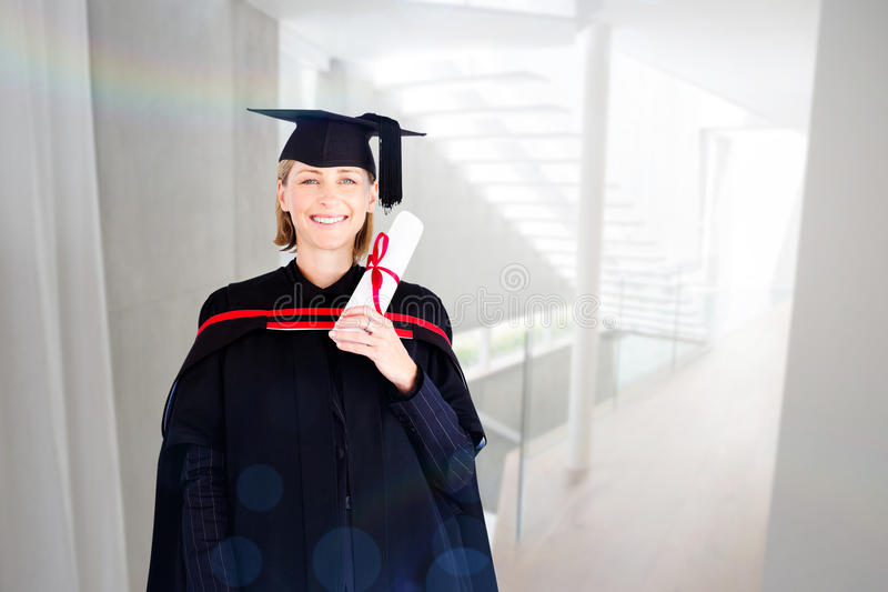 Composite image of happy attractive graduate stock image