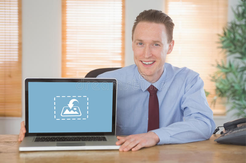 Composite image of happy businessman showing laptop screen. Happy businessman showing laptop screen against photography apps stock image