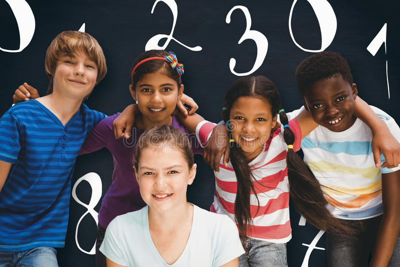 Composite image of happy children forming huddle at park. Happy children forming huddle at park against blackboard royalty free stock images