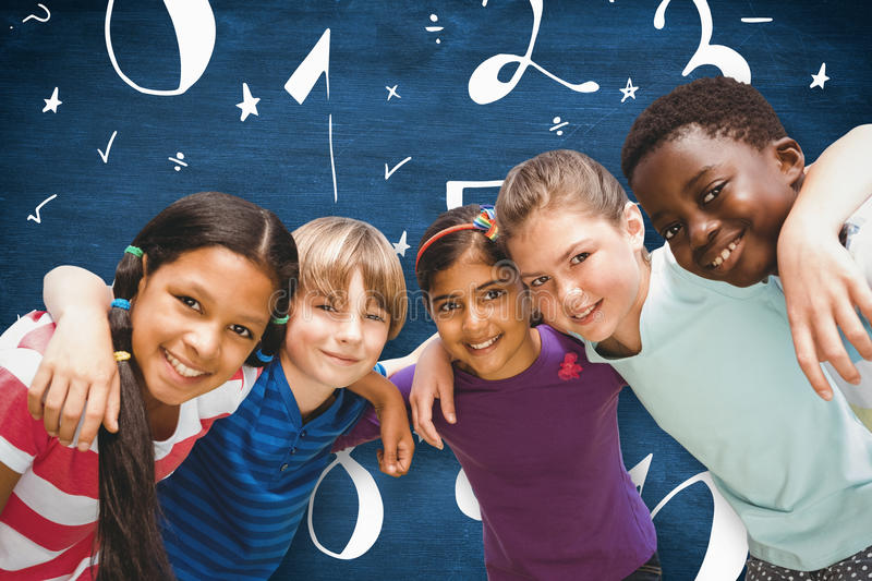 Composite image of happy children forming huddle at park. Happy children forming huddle at park against blue chalkboard royalty free stock photos
