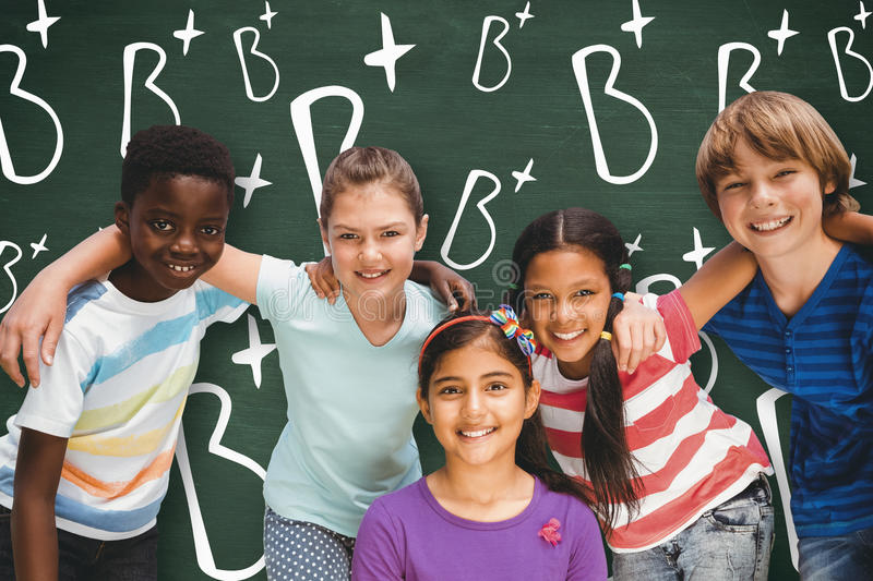 Composite image of happy children forming huddle at park. Happy children forming huddle at park against green chalkboard stock photo