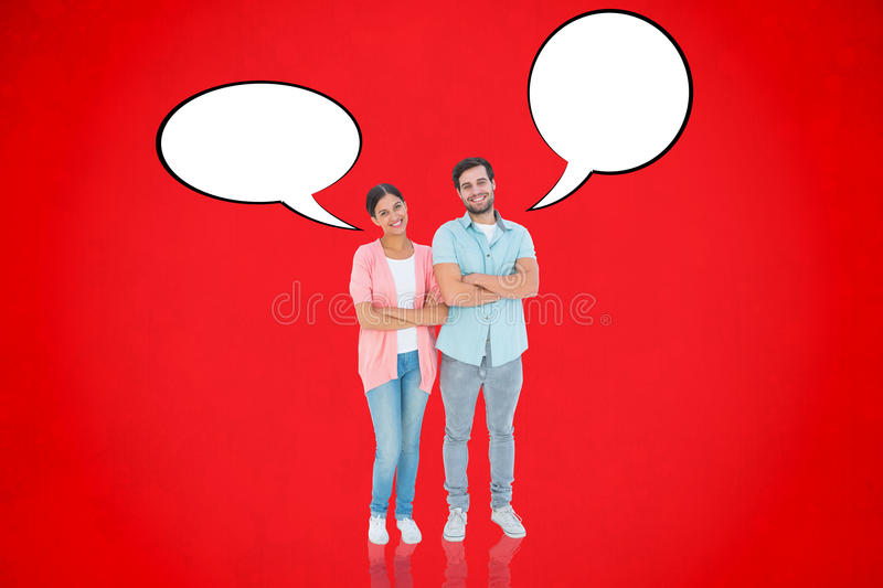 Composite image of happy couple with arms crossed. Happy couple with arms crossed against red background royalty free stock photography