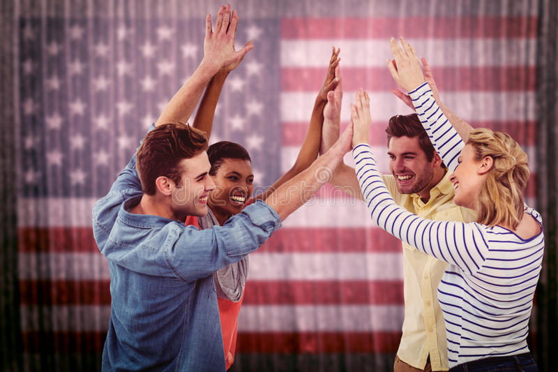 Composite image of happy creative team giving high fives to each other royalty free stock photos