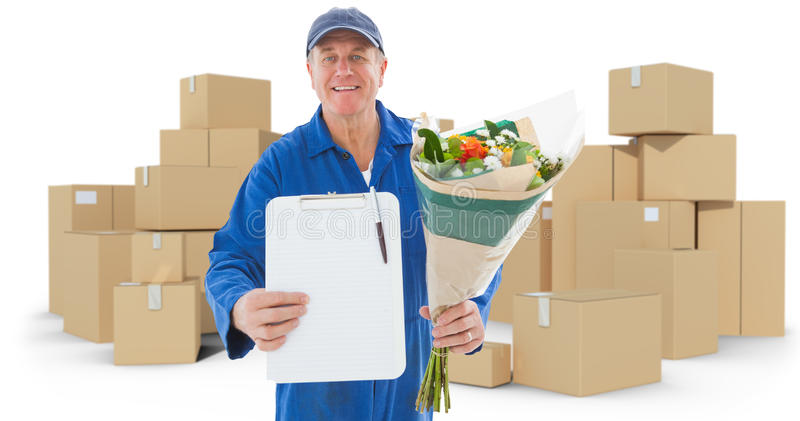 Composite image of happy flower delivery man showing clipboard. Happy flower delivery man showing clipboard against cardboard boxes over white background stock illustration