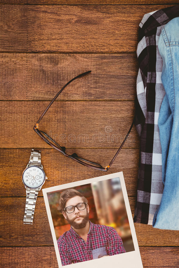 Composite image of happy hipster against wooden fence royalty free stock image