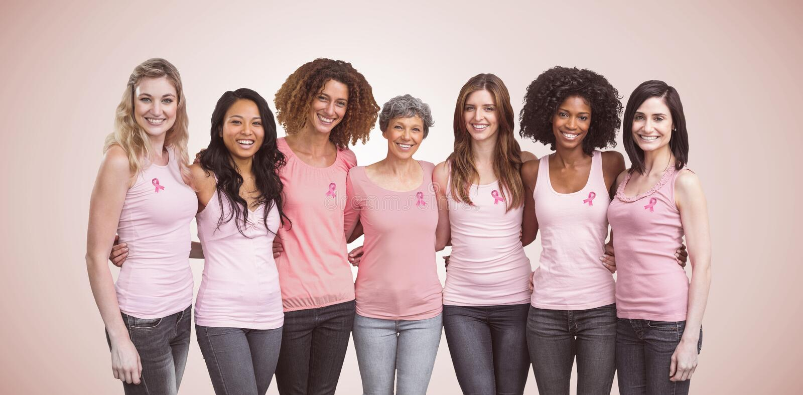 Composite image of happy multiethnic women standing together with arm around. Happy multiethnic women standing together with arm around against neutral stock photography