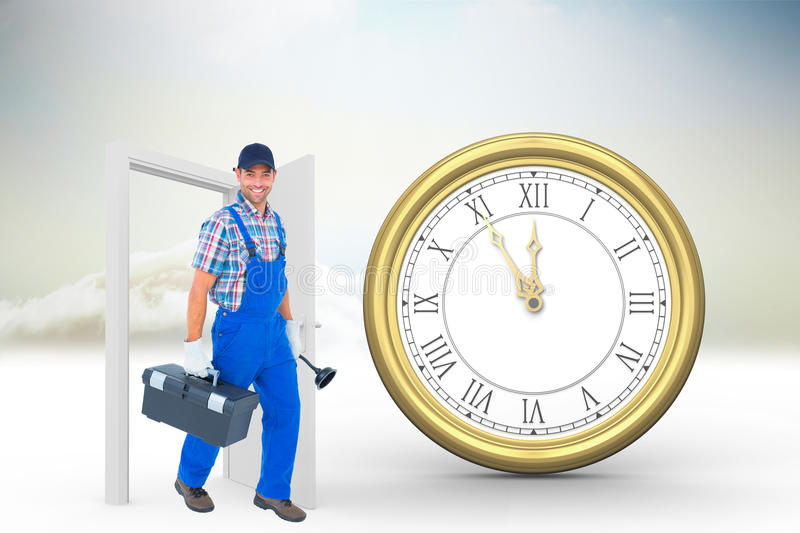Composite image of happy plumber with plunger and toolbox walking on white background stock photo