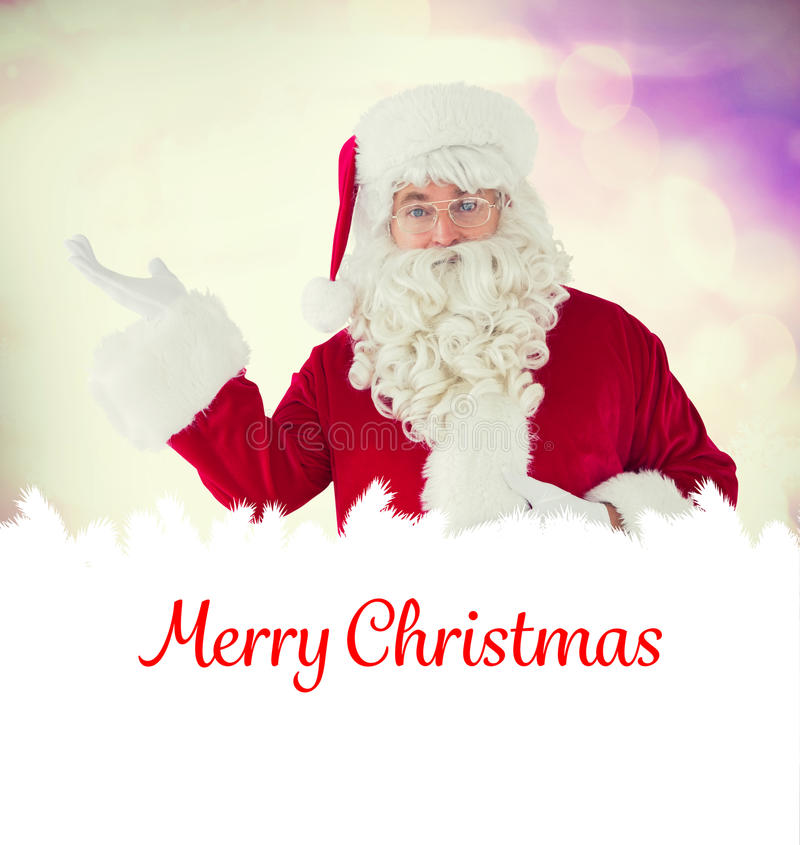 Composite image of happy santa with his hand out royalty free stock photos