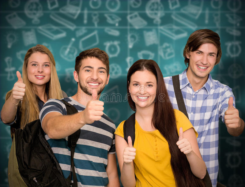 Composite image of happy students gesturing thumbs up at college corridor stock images