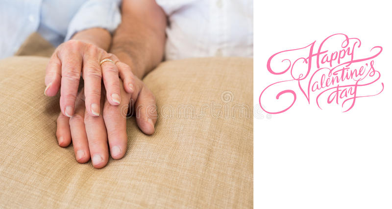 Composite image of happy valentines day. Happy valentines day against retired couple holding hands royalty free stock photos