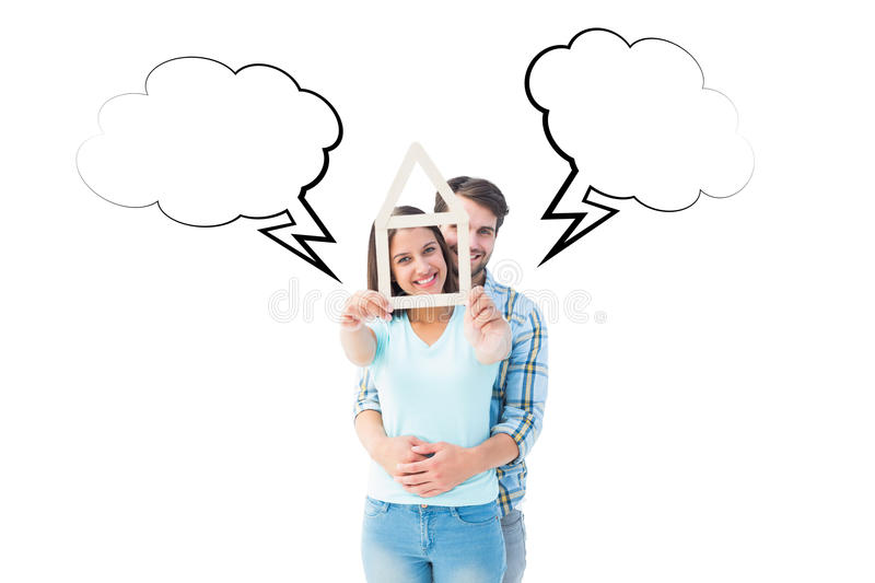 Composite image of happy young couple with house shape. Happy young couple with house shape against speech bubble stock photos