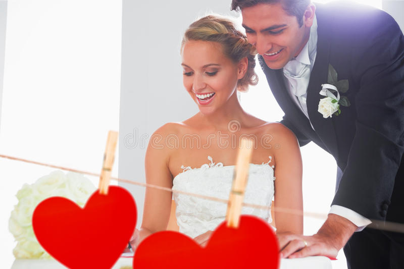 Composite image of happy young couple signing wedding register. Happy young couple signing wedding register against hearts hanging on a line vector illustration
