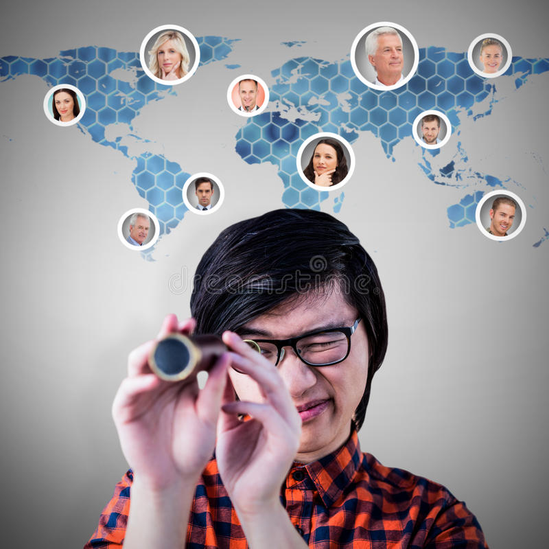Composite image of hipster looking through a telescope. Hipster looking through a telescope against background with hexagons and world map royalty free stock images