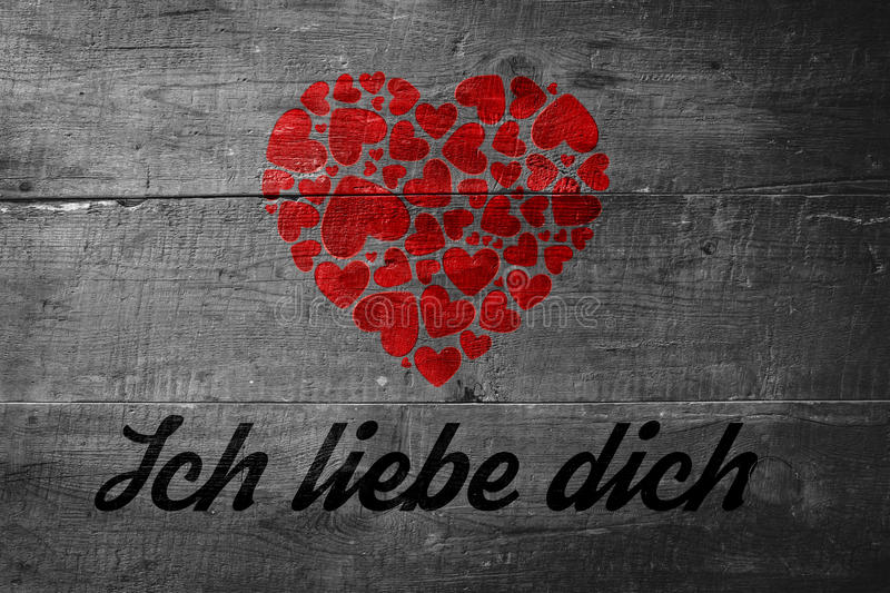 Composite image of ich liebe dich. Ich liebe dich against overhead of wooden planks stock illustration
