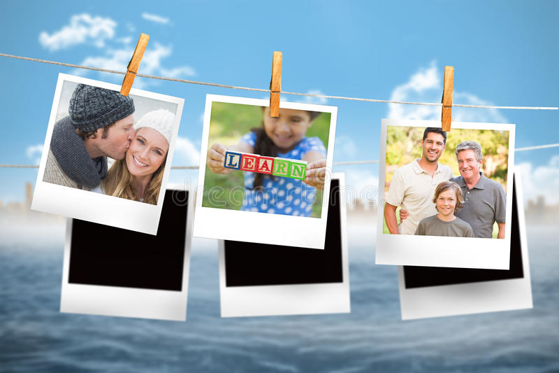 Composite image of instant photos hanging on a line royalty free stock photos