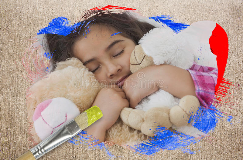 Composite image of little girl cuddling teddys royalty free stock photography