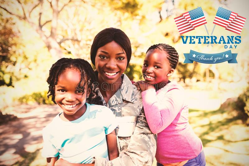 Composite image of logo for veterans day in america. Logo for veterans day in america against portrait of mother and children at park stock photography