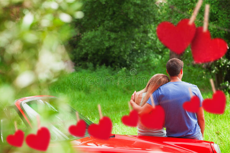 Composite image of loving couple admiring nature while leaning on their cabriolet vector illustration
