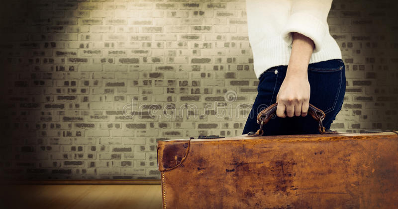 Composite image of low section of woman carrying vintage suitcase royalty free stock images