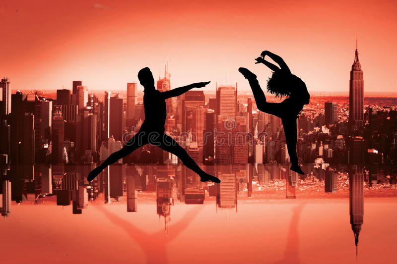 Composite image of male ballet dancer jumping. Male ballet dancer jumping against mirror image of city skyline stock images