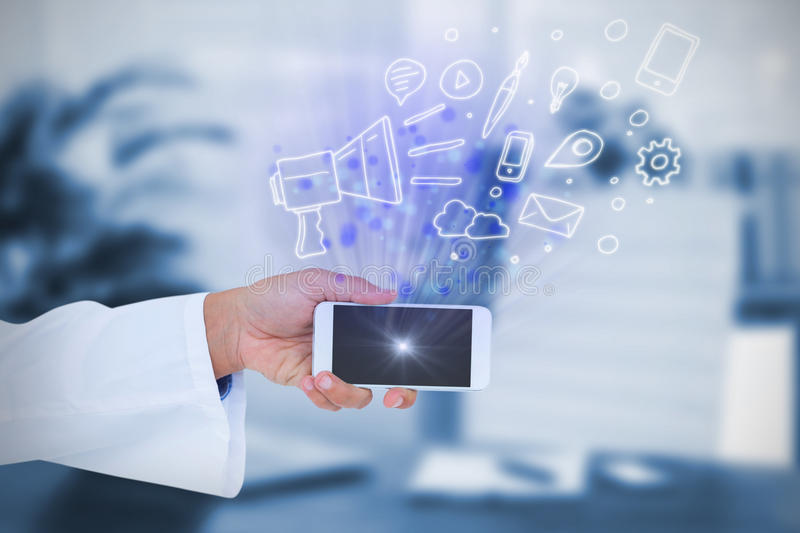 Composite image of male doctor holding smart phone with blank screen stock photos