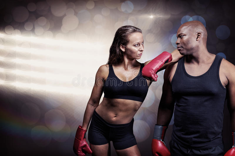 Composite image of male and female boxer looking at each other stock photo