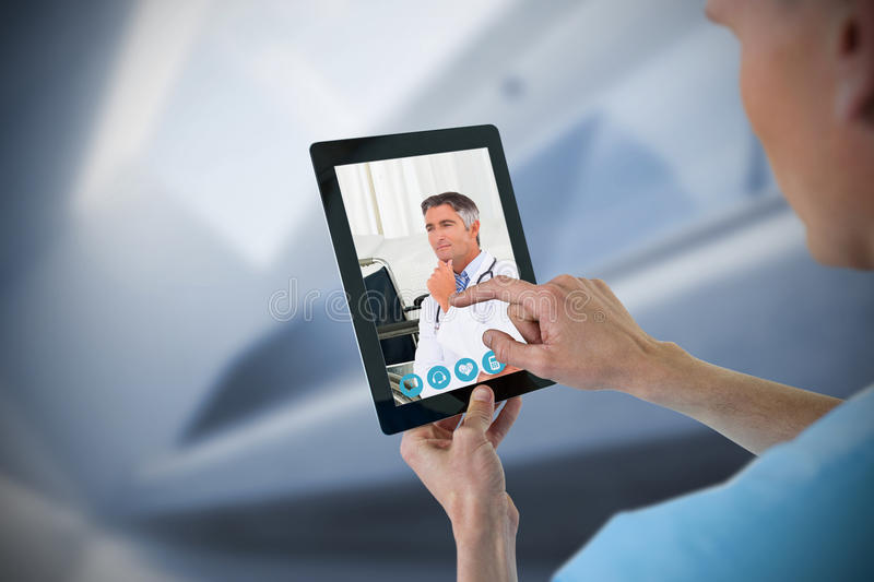 Composite image of male nurse using digital tablet royalty free stock photo