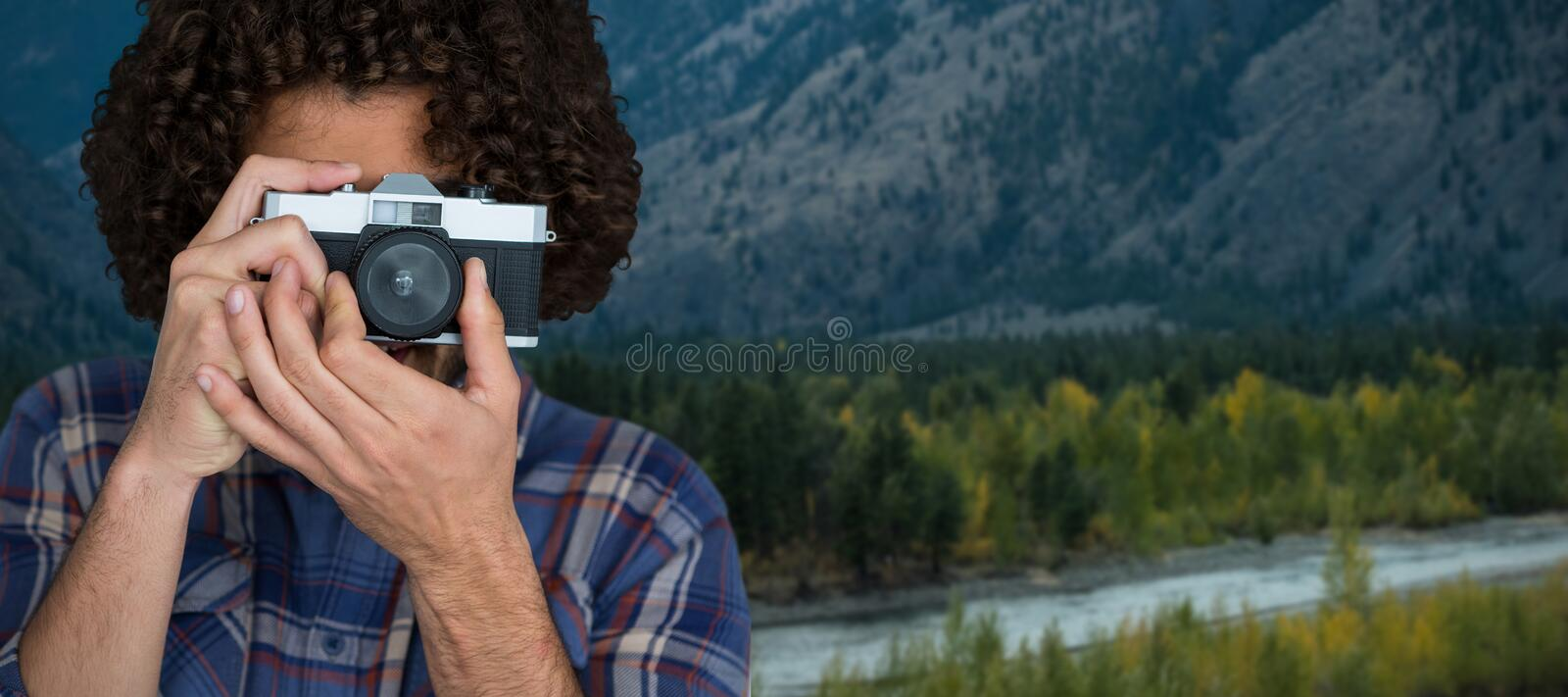 Composite image of male photographer taking picture with camera stock photography