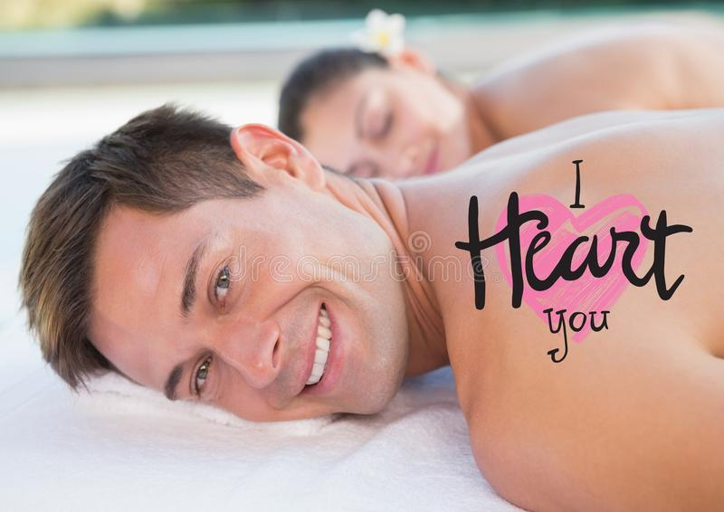 Composite image of man at spa with valentines text stock photo
