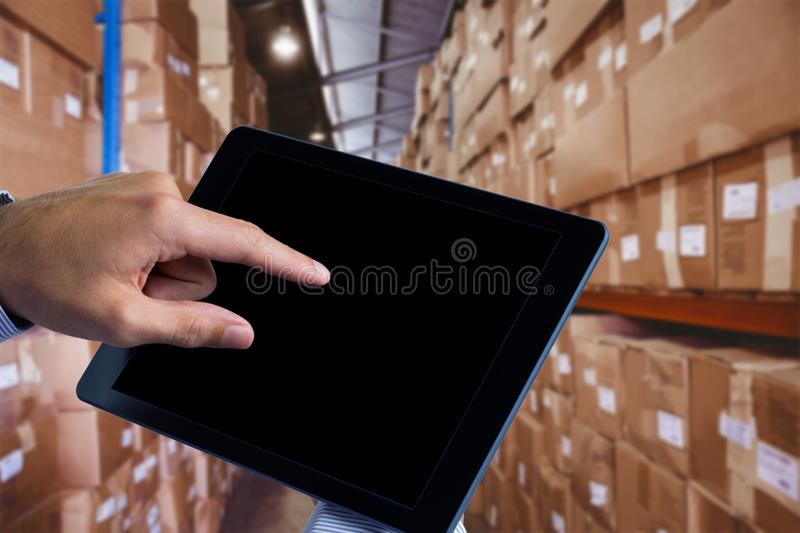 Composite image of man using tablet pc royalty free stock photo