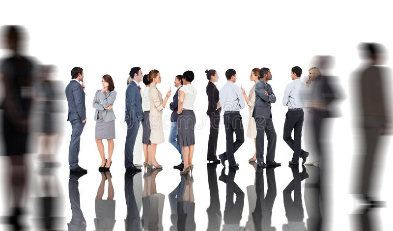 Composite image of many business people standing in a line royalty free stock image