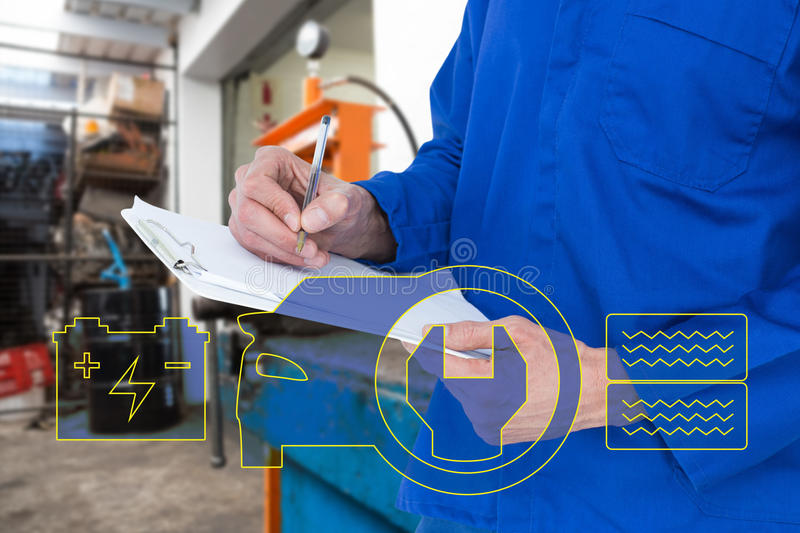 Composite image of mechanic writing notes on clipboard stock photos
