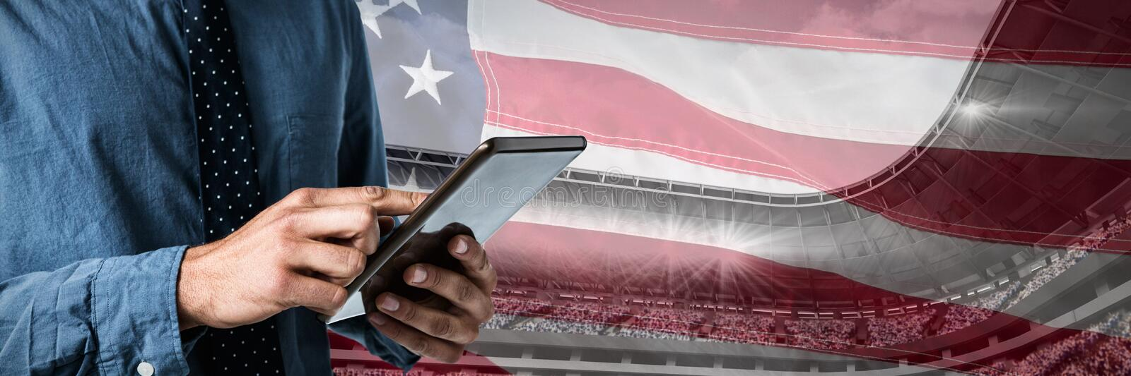 Composite image of mid-section of business man using a tablet royalty free stock photos