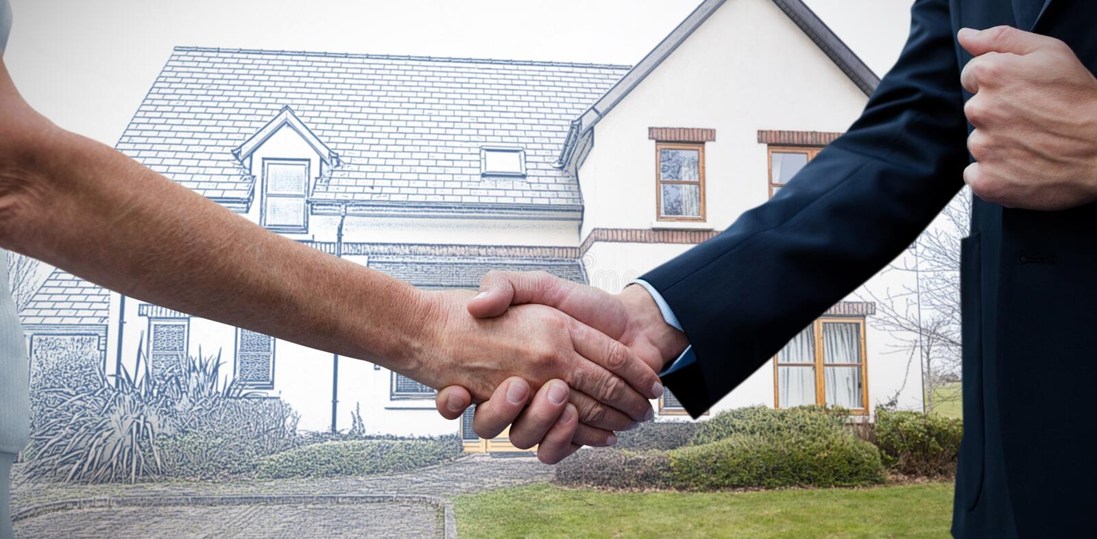 Composite image of mid section of businessman holding woman hand. Mid section of businessman holding women hand against pretty house with a blue and white filter stock photos