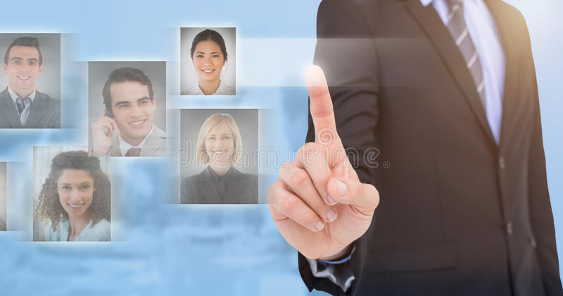 Composite image of mid section of businessman pointing something up stock photography