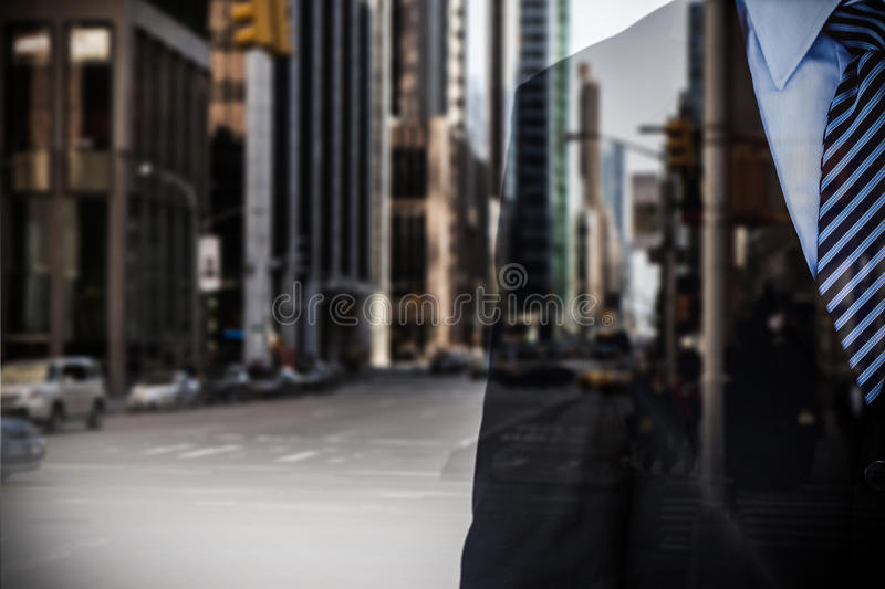 Composite image of mid section of businessman wearing full suit royalty free stock image