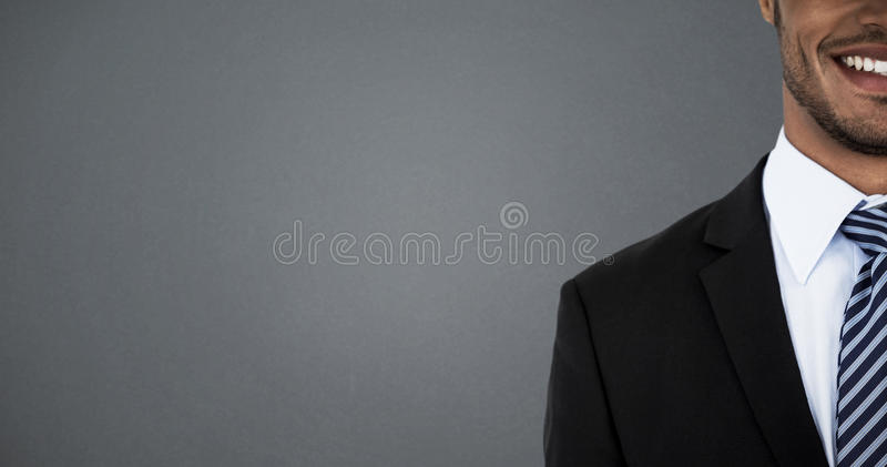 Composite image of mid section of smiling businessman stock photography