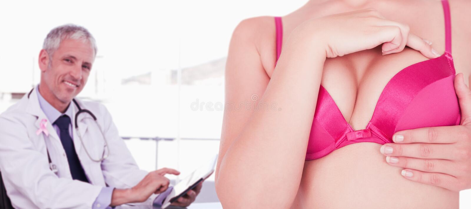 Composite image of mid section of woman in pink bra touching breast for cancer awareness. Mid section of women in pink bra touching breast for cancer awareness stock images