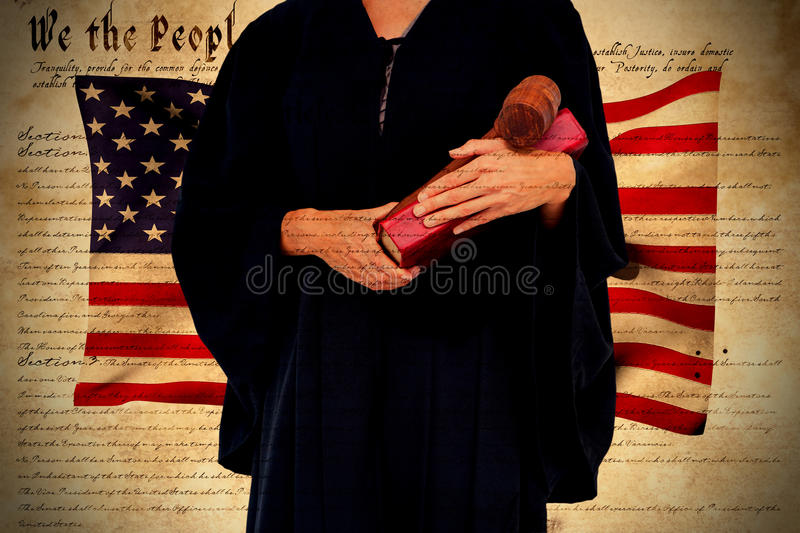 Composite image of midsection of female lawyer holding gavel and book royalty free stock images