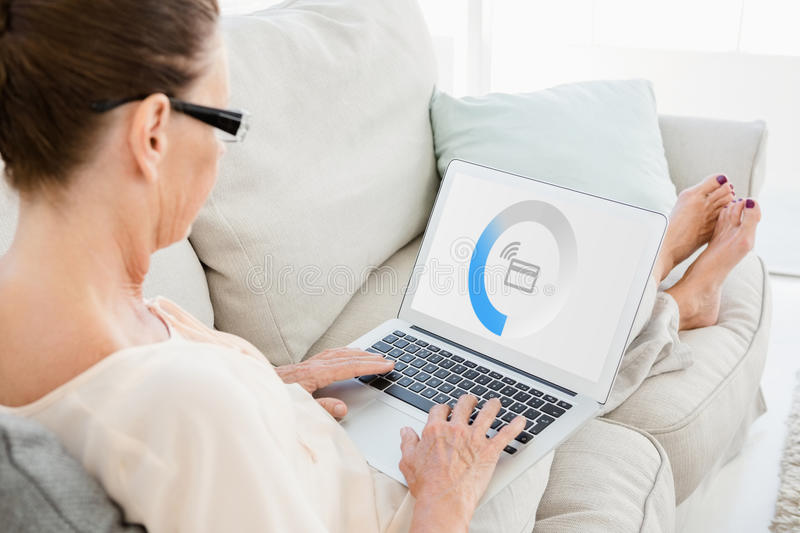 Composite image of monitor screen showing processing with wifi. Monitor screen showing processing with wifi against woman working on laptop royalty free stock images