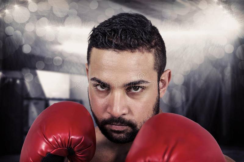 Composite image of muscular man boxing in gloves stock image