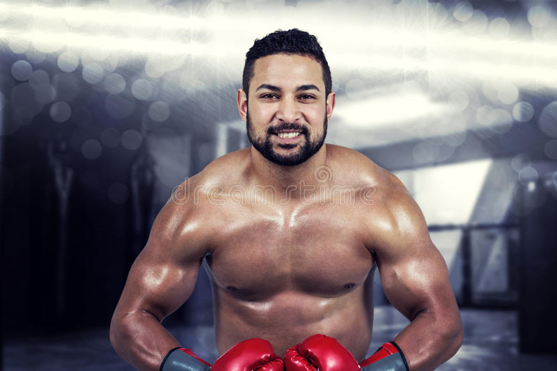 Composite image of muscular man boxing in gloves royalty free stock photography