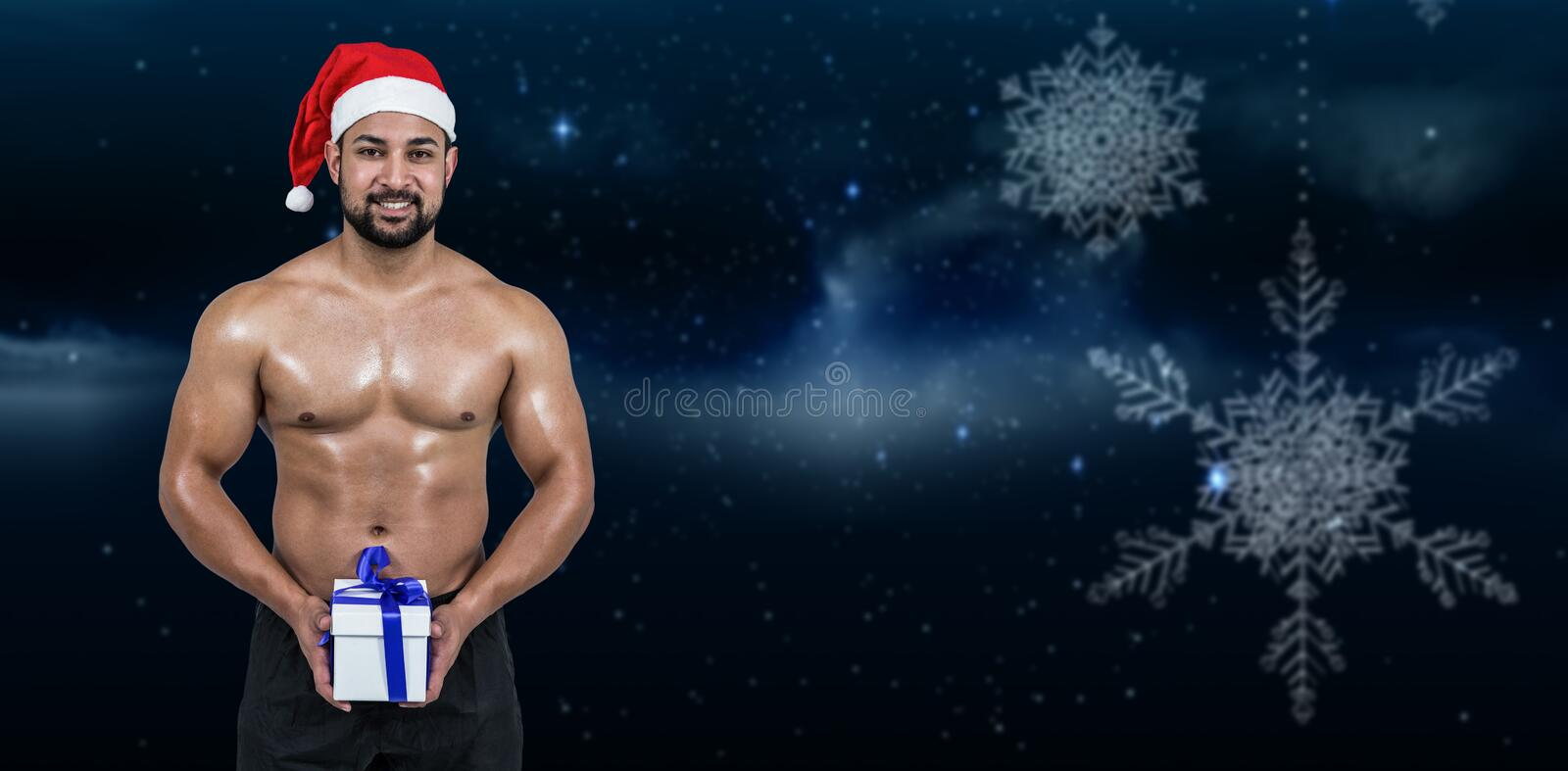 Composite image of muscular man in santa hat stock photography