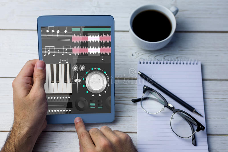 Composite image of music app. Music app against cropped image of person using tablet computer stock images