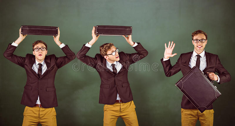 Composite image of nerdy businessman. Nerdy businessman against green chalkboard royalty free stock photo