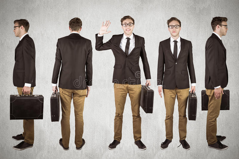 Composite image of nerdy businessman. Nerdy businessman against white and grey background stock photo